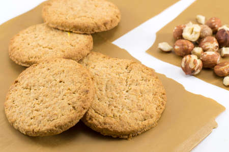 integral: Integral cookies and natural fresh hazelnuts. Healthy dessert Stock Photo