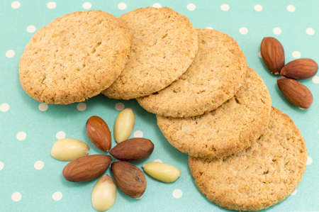 dotted background: Bunch of integral cookies with almonds on blue dotted background Stock Photo