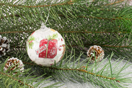 decoupage: Decoupage decorated Christmas ornament and fir tree on shiny background