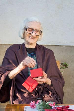 old desk: Happy ninety years old grandma receiving her Christmas present