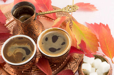 coffee table: Turkish coffee with mix of flowers and sugar. Autumn background