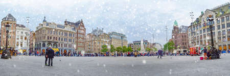 dam square: Panoramic view at Dam square with a first snow, Amsterdam, Netherlands, Europe Editorial