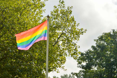 wedding parade: LGBT flag in front of a coffee place in the park in Amsterdam