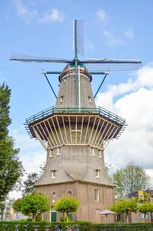 the netherlands: Old windmill in Amsteredam city, Netherlands, Europe Stock Photo