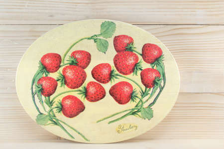 decoupage: Decoupage decorated strawberry pattern plate against wooden background Stock Photo