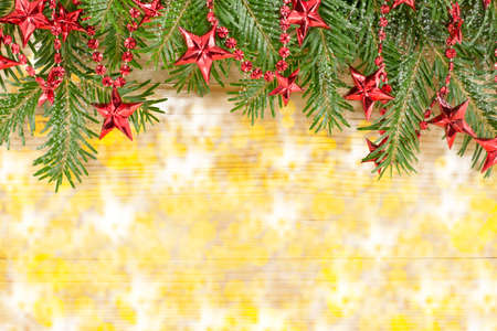 fir  tree: Shiny Christmas background with red ornaments and fir tree Stock Photo