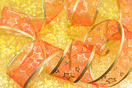 Decorative shiny red tape on golden holiday background Stock Photo
