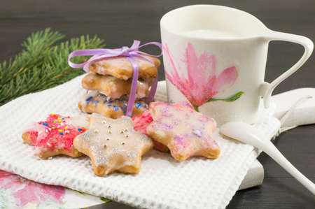 decoupage: Home baked and decorated Christmas cookies and milk in decoupage decorated cup Stock Photo