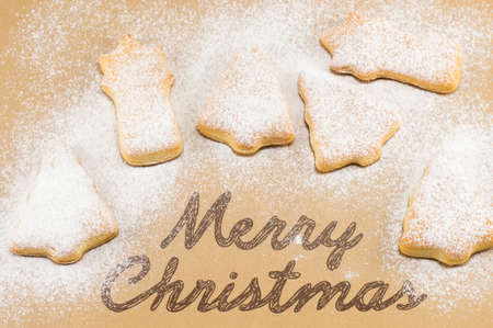 christmas cooking: Home baked and shaped sweet Christmas cookies dessert with a Merry Christmas note Stock Photo