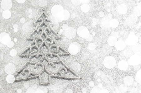 Christmas tree decoration with bokeh silver background. Celebrating Christmas