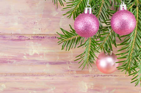 pink decorations: Festive Christmas background with ornaments and fir tree branch