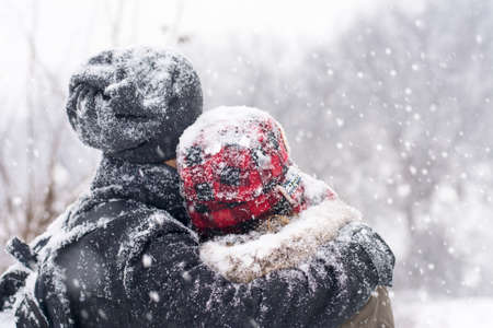 covered in snow: Couple in love having fun outdoors on a snowy winter day