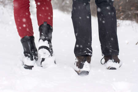 girl in nature: Couple in love outdoors walking on snowy winter day Stock Photo
