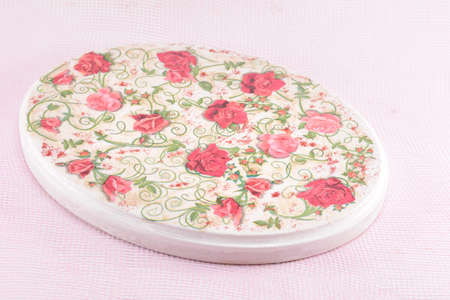pink decorations: Decoupage decorated rose pattern plate on pink background