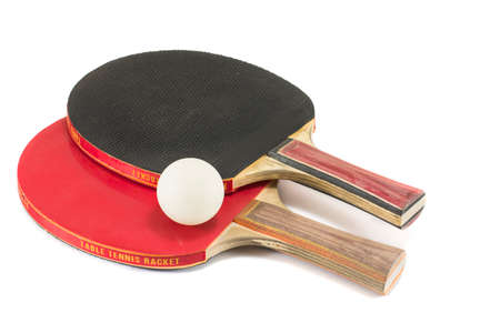 Two ping-pong rackets and a ball isolated