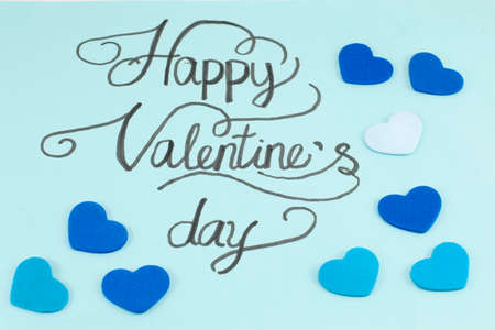 writting: Blue card with a handwritten happy valentines day inscription