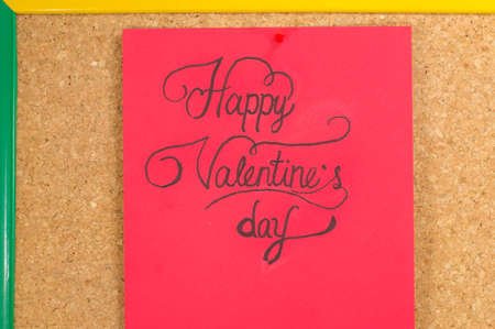 writting: red card with a handwritten Happy Valentines inscription on a board Stock Photo