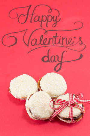 original idea: Red Valentines day card and homemade cookies Stock Photo