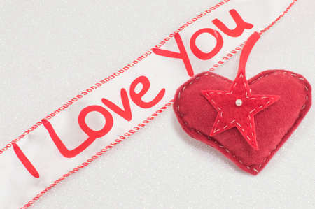 i love you sign: Ribbon with the I love you sign and red hearts Stock Photo