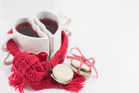 two and a half: heart shaped mug with tea with a red scarf