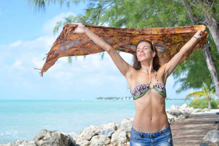 cover up: brunette playing with her cover up in Florida Stock Photo