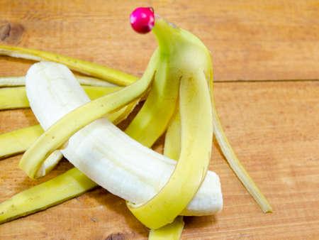 peeled banana and banana skin on a table