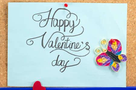 Blauwe kaart met de dag een handgeschreven gelukkige valentijnskaart inscriptie