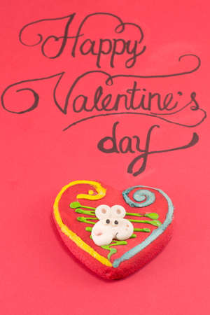 do it yourself: red card with a handwritten Happy Valentines inscription on a board Stock Photo