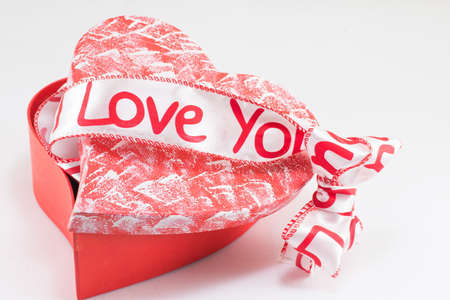 love image: heart shaped box with I love you ribbon on top of it Stock Photo