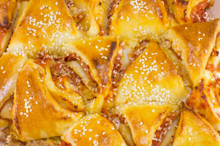 triangle shaped: homamade triangle shaped pizza pastry close up Stock Photo
