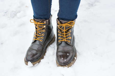 leather boots: Girl wearing leather boots in snow Stock Photo