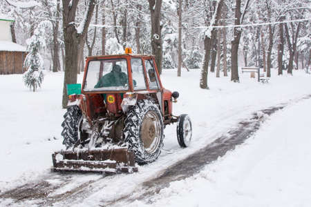heavy snow: Dredge cleaning the roads from the heavy snow Stock Photo