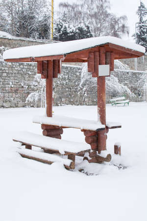 heavy snow: summer house covered with heavy snow