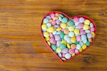 heart shaped box: Heart shaped box filled with small chocolates balls
