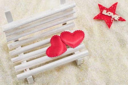 two hearts: Two hearts on a miniature wooden bench with a love note