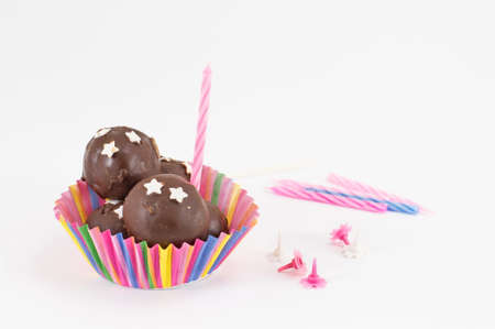chocolate balls: chocolate balls and candles on white background Stock Photo