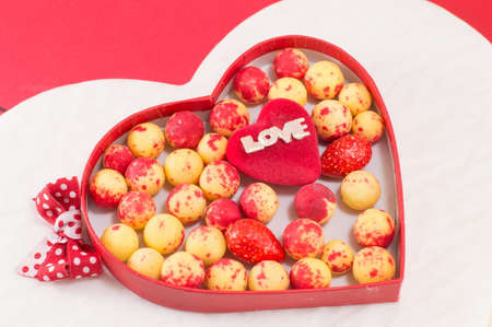 heart shaped box: heart shaped box with red and yellow candy balls