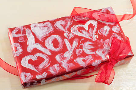 love image: red handmade box for Valentines with a red ribbon
