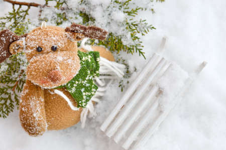 blue santa: Snow covered reindeer toy with sledges