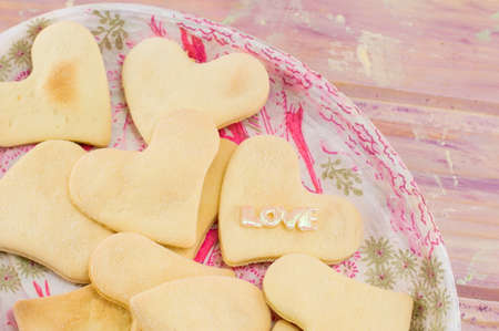 shaped: heart shaped biscuits on a decoupage plate