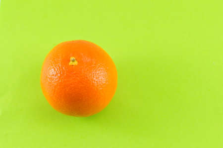 green and white: Whole orange on complementary green background