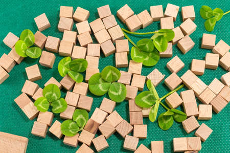 patrick: St. Patrick decoration with clover and small wooden cubes Stock Photo