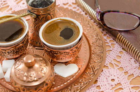 pleasent: Turkish coffee served in traditional copper pottery and a book for a pleasent time