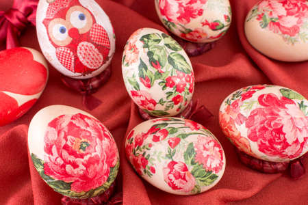 soft background: Decoupage decorated Easter eggs on red silk