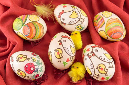 background pattern: Decoupage decorated Easter eggs on red silk