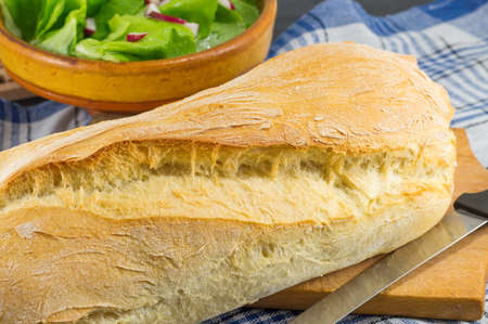 home baked: Home baked bread and a knife on the table