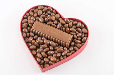 i love you sign: heart shaped box filled with chocolate with an I love you sign