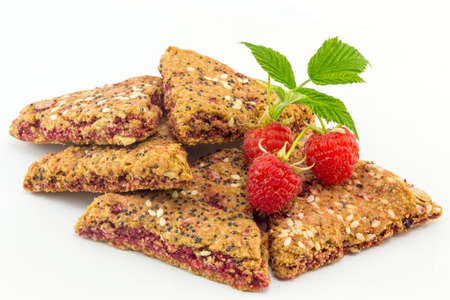 integral: Integral biscuits with fresh red raspberry fruit Stock Photo