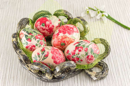 decoupage: Decoupage decorated Easter eggs in a basket