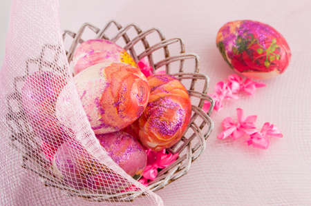 decoupage: Pink decoupage decorated Easter eggs in a wicker basket
